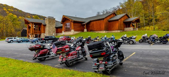 Motorcyclist stopped at the PA Lumber Museum, one of the key attractions on the PA Wilds-East Loop across US Route 6. (Photo courtesy of Curt Weinhold)