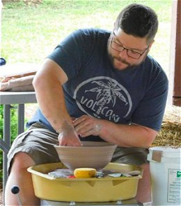 Geno Boni works on a bowl at the 2017 Art in the Wilds show